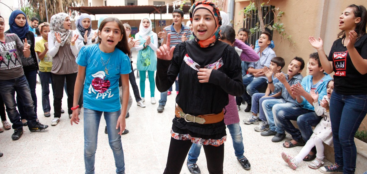 """Amani, aged 12, is learning English, French and Arabic, and is also recieving psychosocial support to help her forget the conflict in Syria. Her family were displaced inside Syria for 2 years before moving to Lebanon six months ago.   """"I feel so happy that I'm now learning again"""", she says."""