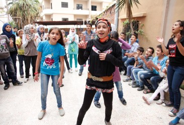"Amani, aged 12, is learning English, French and Arabic, and is also recieving psychosocial support to help her forget the conflict in Syria. Her family were displaced inside Syria for 2 years before moving to Lebanon six months ago.   ""I feel so happy that I'm now learning again"", she says."