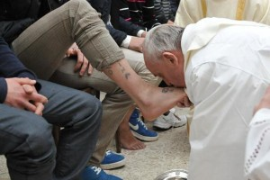 Washing feet is for the spiritual elite who receive the Second Anointing, not for common people! Way to throw pearls before swine! That foot has TATTOOS! Disgusting.